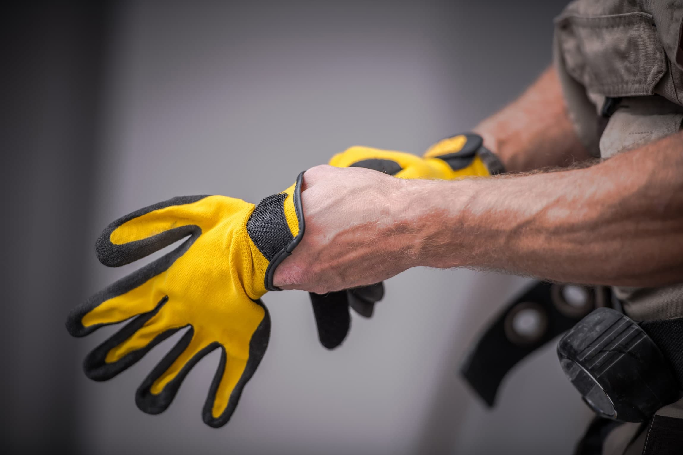 wearing-safety-gloves-PDWDQ2P (1) (1)